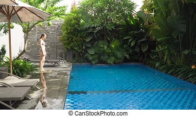 Girl is swimming in the pool.