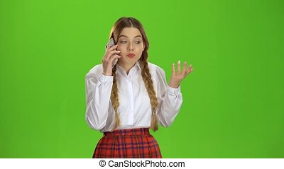 Girl is talking on the phone. Green screen