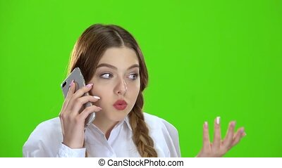 Girl is talking on the phone . Green screen - Girl is...
