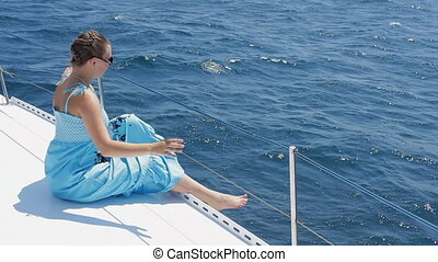 Girl is tanning on a yacht HD