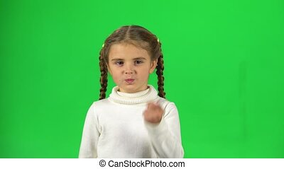 Girl is unsatisfied and shaking her index finger on green screen