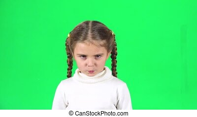 Girl is unsatisfied and shaking her index finger on green screen. Slow motion