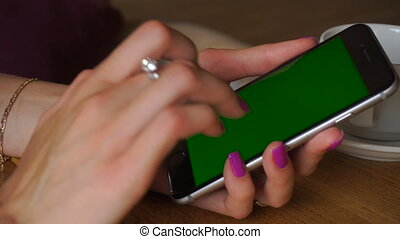 girl is using a mobile phone with green screen