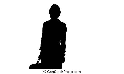 Girl is waiting and looks at the clock she holds in her hand a case . White background. Silhouette