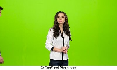 Girl is waiting for her beloved guy, he comes and gently hugs. Green screen