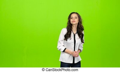 Girl is waiting for her beloved guy, he comes and gently kisses. Green screen