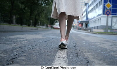 Girl is walking along the road markings - Gorgeous asian...