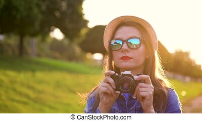 Girl is walking around the city and taking photos of nature...