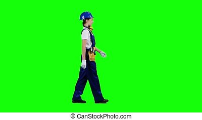 Girl is walking in a helmet to work. Green screen. Side view