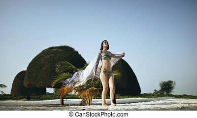 Girl is walking slowly along the tropical beach - Beautiful...