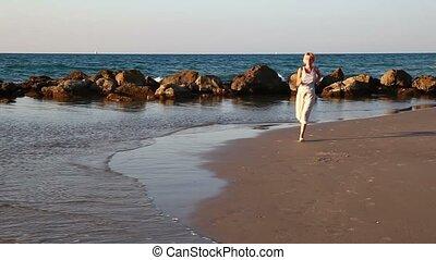 Girl jogging along a Beach    3