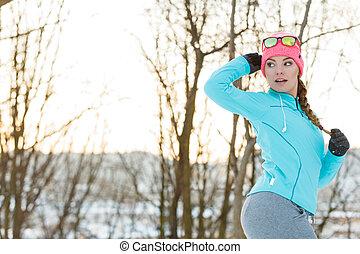 Girl jogging in winter park