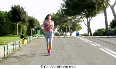 girl jogging on street doing sport