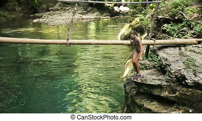 Girl jump into water