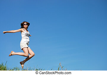 girl jumping against the beautiful sky
