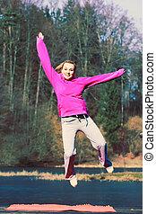 Girl jumping in park.