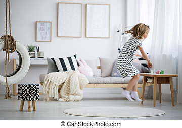Girl jumping in room
