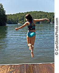Girl Jumping Into Lake
