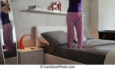 Girl Jumping On Bed Success For Happy Young Woman