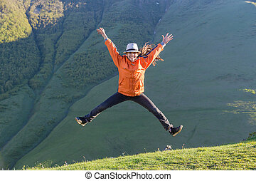 Girl jumping on hill