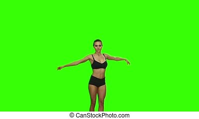Girl jumps bending the knees. Green screen. Slow motion -...
