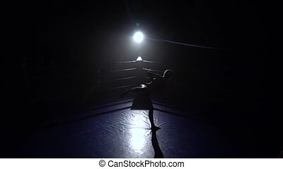 Girl jumps in place and beats her feet . Silhouette. Slow...