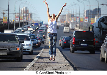 girl jumps on highway middle