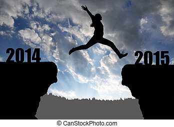 Girl jumps to the New Year 2015 at sunset
