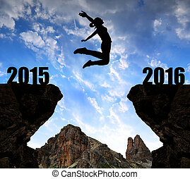 Girl jumps to the New Year 2016 at sunset