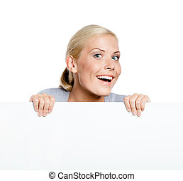Girl keeping huge sheet of paper