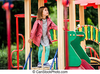 Girl kid playing on park playground
