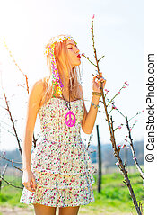 Girl kisses the blossoming of a flower in spring