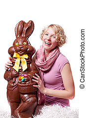 Girl Laughing and Holding a HUGE Chocolate Easter Bunny
