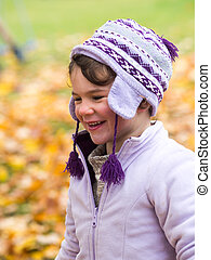 Girl laughing in autumn