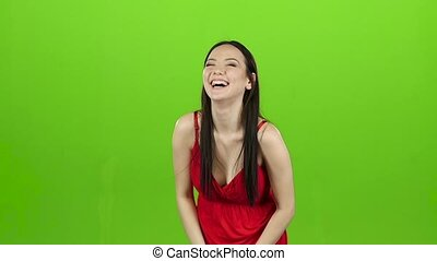 Girl laughing loudly at her beautiful smile. Green screen....