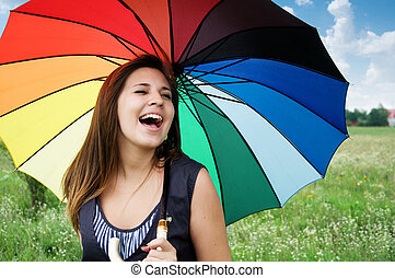 girl laughing - beautiful young girl with a colorful...