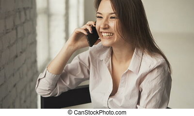 Girl Laughing while Talking on Phone