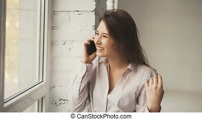 Girl Laughs While Talking on Phone