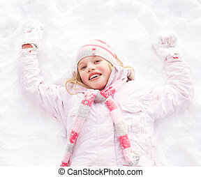 Girl Laying On Ground Making Snow Angel