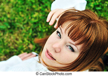 girl laying on the spring meadow