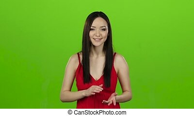 Girl leading a column of news on television. Green screen. Slow motion