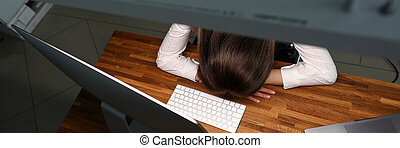 Girl leaned over table office, sleeps with fatigue. Constant...