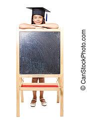 Girl leaning on blackboard
