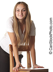 Girl leaning on chair