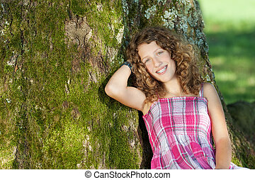 Girl Leaning On Tree Trunk
