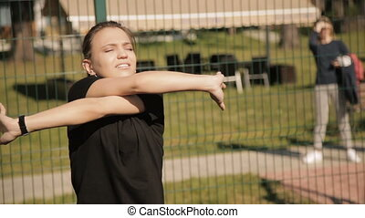 Girl learning stretching in the nature outdoors