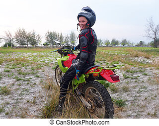 Girl learning to ride an enduro motorcycle 4