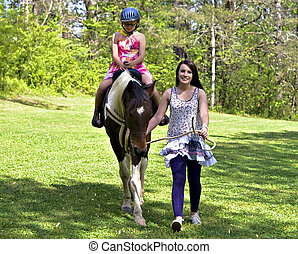 Girl Learning to Ride Horse