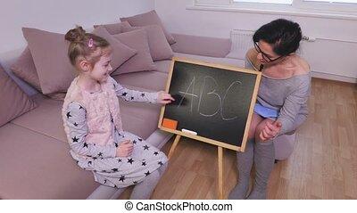 Girl learns the alphabet