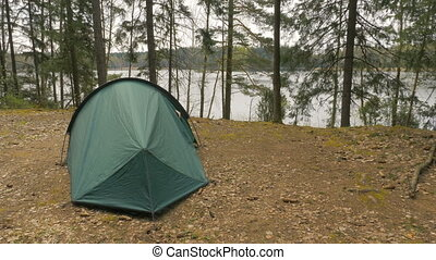 Girl leaves the tent in the forest